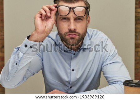 Steadfast glance of the serious office worker Royalty-Free Stock Photo #1903969120