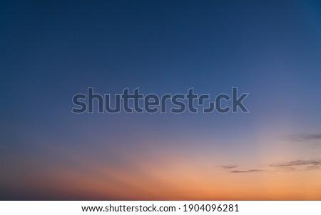 Evening Sky on Twilight background with colorful Sunset Cloud fluffy Orange Sunlight, Dusk sky nature background  Royalty-Free Stock Photo #1904096281