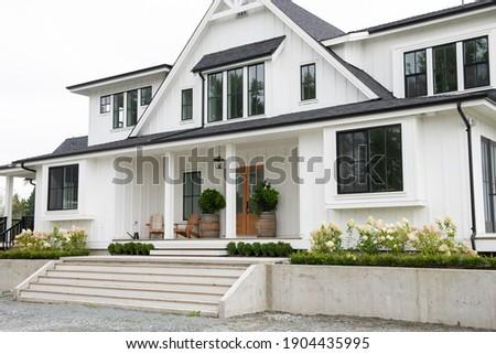 North American modern Belgian-style farmhouse Royalty-Free Stock Photo #1904435995