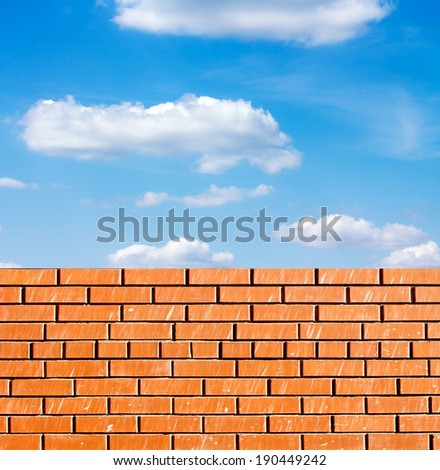 red brick wall against blue sky #190449242