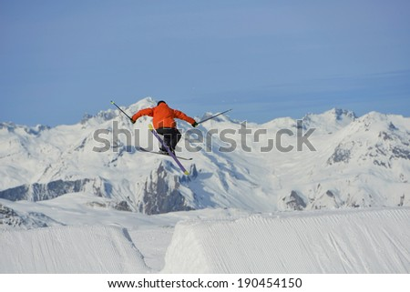 jumping skier at mountain winter snow fresh suny day #190454150