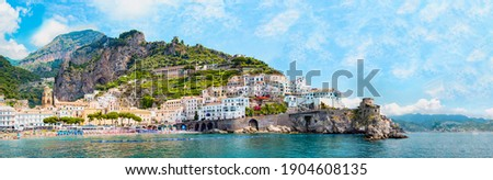 Panoramic view, aerial skyline of small haven of Amalfi village with tiny beach and colorful houses located on rock. Tops of mountains on Amalfi coast, Salerno, Campania, Italy. Royalty-Free Stock Photo #1904608135