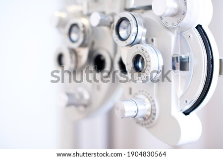 Phoropter, ophthalmic testing device machine, close up, selective focus Royalty-Free Stock Photo #1904830564