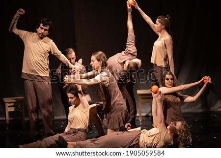 Actors and actresses play a modern lyrical performance of the theater stage show Royalty-Free Stock Photo #1905059584