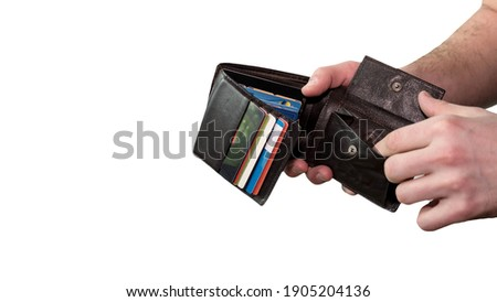 A man with a wallet in his hands, credit cards in a wallet is isolated on a white background, a man with a financial problem, an empty wallet without money.