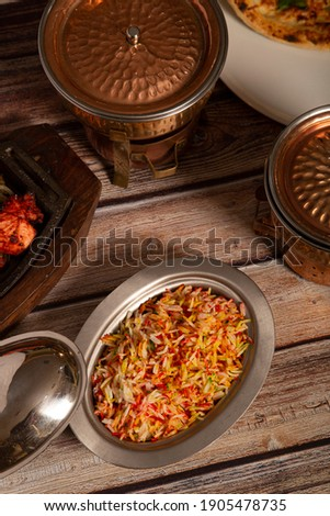 Indian curry meal with basmati rice dish. Vertical picture