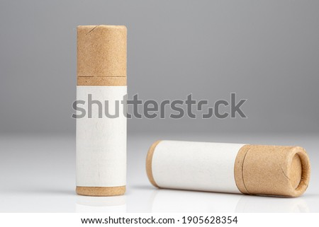 Zero Waste Lipstick packaging. Lip balm tube made of paper. Blank label mock up. Copy space for text Royalty-Free Stock Photo #1905628354