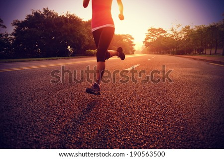 Runner athlete running at road. woman fitness sunrise jogging workout wellness concept.  #190563500