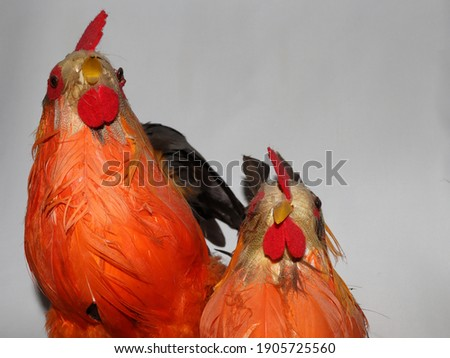 orange chicken and rooster with miniature decor