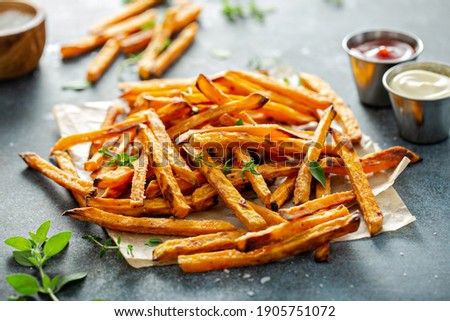 Sweet potato fries with mayo and ketchup, homemade roasted in the oven Royalty-Free Stock Photo #1905751072