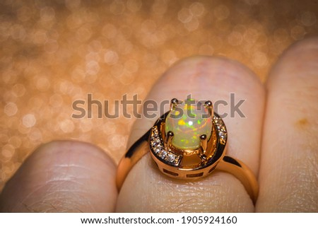 Fashion rose gold ring with a bright rainbow flash opal stone.