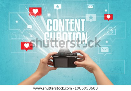 Close-up of a hand taking photos with CONTENT CURATION inscription, social media concept