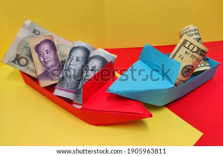 The downfall of the US dollar. The USA and China fight for supremacy in origami boats.