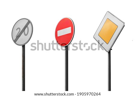 Old railroad signs: speed limit is over, no entry, main road. Isolated on white background.