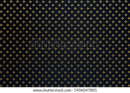 Elegant and rich abstract textile background. Gold monograms on the dark background. The royal robe.