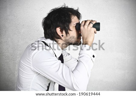 Young businessman spying  #190619444