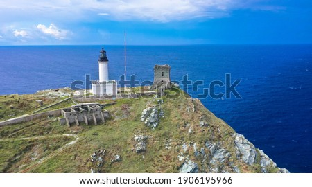 Drone view from Giraglia island on the northern tip of Cap Corse, famous for its lighthouse and Genoese tower, both of which are historical monuments. Barcaggio village, Corsica, France