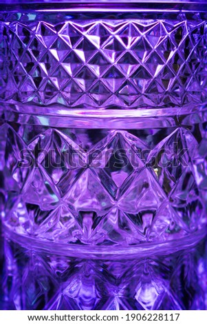 purple background of glass material form kaleidoscope with symmetry and design