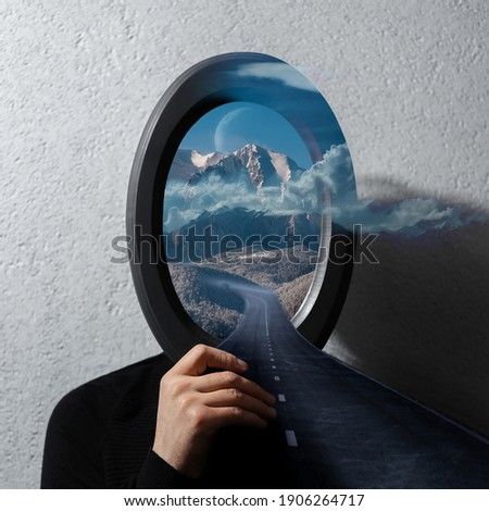 Contemporary artwork collage concept. Man holding black frame on face with beautiful landscape of cloudy mountains and asphalting road. Royalty-Free Stock Photo #1906264717