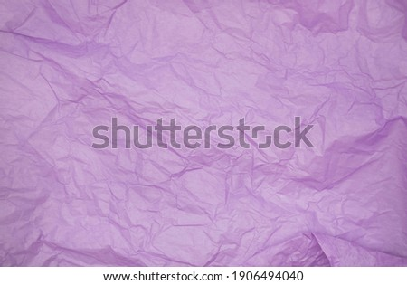 purple color creased paper tissue background texture. wrinkled tissue paper texture Royalty-Free Stock Photo #1906494040