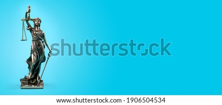 Lady Justice isolated on blue background. Panorama Banner. Symbol of law or lawyer. Royalty-Free Stock Photo #1906504534