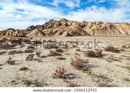 Deserted area overlooking the mountains Royalty-Free Stock Photo #1906512955