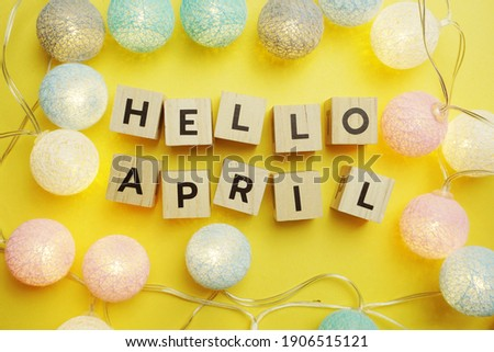 Hello April alphabet letter with LED Cotton ball Decoration on yellow background Royalty-Free Stock Photo #1906515121