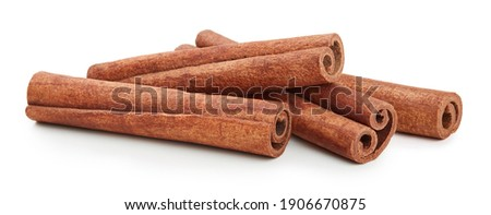 Cinnamon sticks isolated on white background Royalty-Free Stock Photo #1906670875