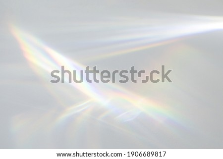 Blurred water texture overlay effect for photo and mockups. Organic drop diagonal shadow and light caustic effect on a white wall. Shadows for natural light effects Royalty-Free Stock Photo #1906689817