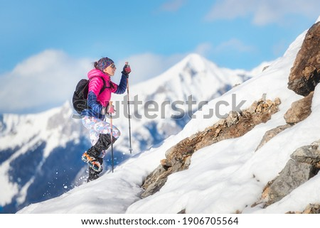 Woman mountaineer during a descent with crampons on snowy slope Royalty-Free Stock Photo #1906705564