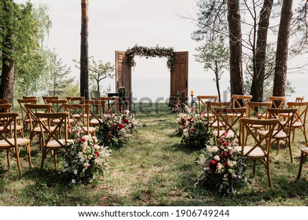Ceremony, arch, wedding arch, wedding, wedding moment, decorations, decor, wedding decorations, flowers, chairs, outdoor ceremony in the open air, bouquets of flowers.  Royalty-Free Stock Photo #1906749244