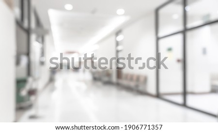 Medical clinic blur background hospital service center in patient's ward blurry perspective view of interior white room, lab corridor hallway, lobby or walkway for nursing care healthcare service Royalty-Free Stock Photo #1906771357