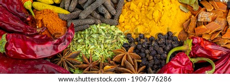 Various spices, peppers and herbs close-up top view. Eastern spice market. A set of peppers and spices for cooking. Royalty-Free Stock Photo #1906776286