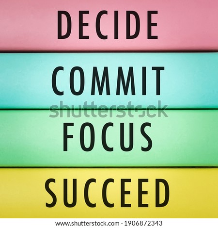Motivational and inspirational quotes - Decide, commit, focus, succeed with wooden background.