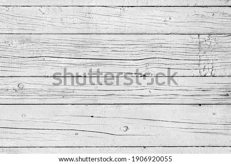 Wooden background. Old black and white painted fence in good condition. Solid wooden wall from weathered cracked boards. Barn wood wall. Royalty-Free Stock Photo #1906920055