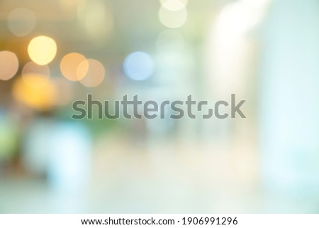 abstract blur image background of shopping mall with light bokeh and flare light bulb Royalty-Free Stock Photo #1906991296
