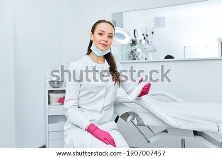 Portrait young beautiful cosmetologist in cosmetology cabinet. Beautiful caucasian woman on a cosmetology procedure. Wellness center. Healthcare, clinic, cosmetology Royalty-Free Stock Photo #1907007457