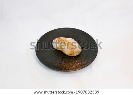 Scallop Sushi or Hotate Sushi in black plate, isolated on white background. Simply use for Japanese Restaurant as Sushi Menu