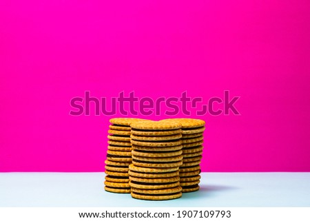 Round biscuits with chocolate cream, sandwich biscuits with chocolate filling isolated. Royalty-Free Stock Photo #1907109793