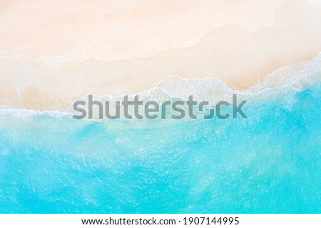 Relaxing aerial beach scene, summer vacation holiday template banner. Waves surf with amazing blue ocean lagoon, sea shore, coastline. Perfect aerial drone top view. Peaceful bright beach, seaside Royalty-Free Stock Photo #1907144995