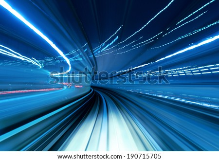 Train moving fast in tunnel  Royalty-Free Stock Photo #190715705