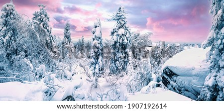 Panoramic landscape with blue color, mountains, forest, sunrise and snow cover. Ural, Russia Perm Krai Stone City. Royalty-Free Stock Photo #1907192614