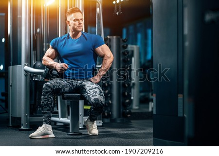 young handsome sportsman bodybuilder with muscle body have workout in gym Royalty-Free Stock Photo #1907209216