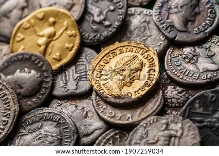 A treasure of Roman gold and silver coins.Trajan Decius. AD 249-251. AV Aureus.Ancient coin of the Roman Empire.Authentic  silver denarius, antoninianus,aureus of ancient Rome.Antikvariat. Royalty-Free Stock Photo #1907259034