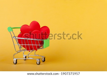 hearts in shopping grocery cart, shopping handcart Royalty-Free Stock Photo #1907371957