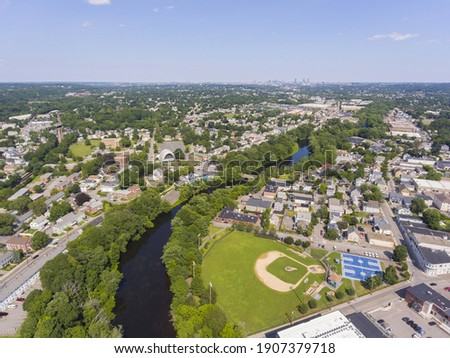Waltham historic city center and Charles River aerial view with Boston city skyline at the background, Waltham, Massachusetts MA, USA.