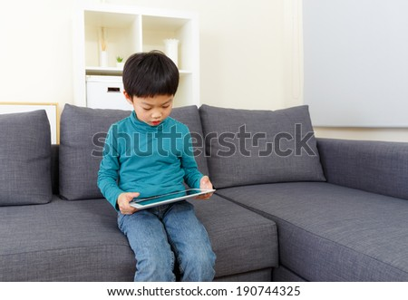 Little boy using tablet computer #190744325