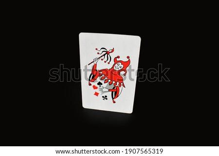 joker card in a black background