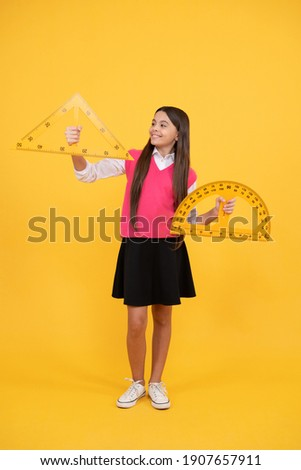 Math and geometry. stem disciplines. concept of education. angle degree measurement. child with triangle. smiling teen girl hold protractor ruler. back to school. algebra and geometry. kid study math.