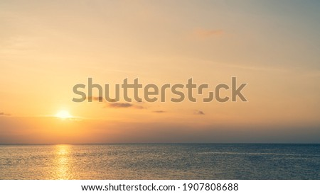 Sunset sky over sea in the evening with colorful sunlight on dusk sky. Royalty-Free Stock Photo #1907808688